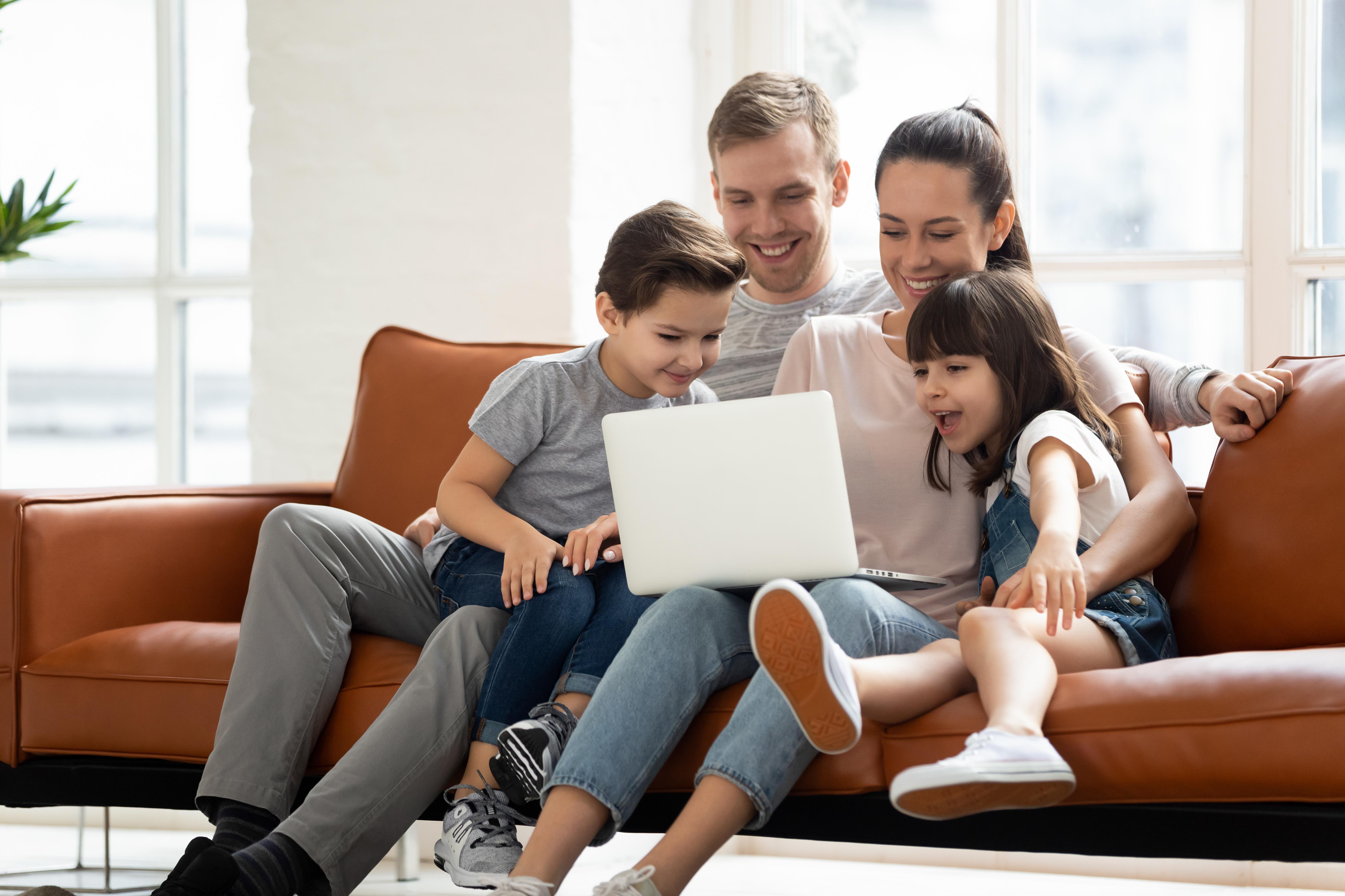 family enjoying Internet on laptop